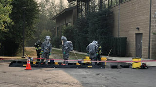 Hazmat crews respond to acid spill, now contained