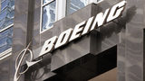 The Boeing logo hangs on the corporate world headquarters building of Boeing November 28, 2006 in Chicago, Illinois.  (Photo by Scott Olson/Getty Images)