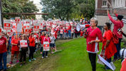 Amid the din of a striking teachers rally outside district offices on Wednesday, Sept. 12, 2018, Tacoma school officials outline the compensation package offered during the latest bargaining session at a press conference. Peter Haley / Drew Perine