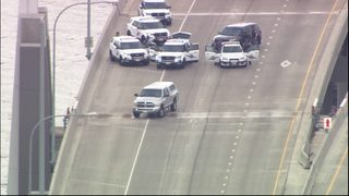 Man in custody after police response shuts down 520 floating bridge