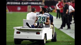 Thomas gestures toward Seattle Seahawks sideline after broken leg