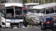 A charter bus, left, and an amphibious tour vehicle remain on the Aurora Bridge after colliding in a deadly crash involving several vehicles Thursday, Sept. 24, 2015, in Seattle. (AP Photo/Elaine Thompson)