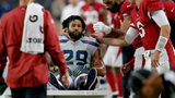 Seattle Seahawks defensive back Earl Thomas is greeted by Arizona Cardinals players as he leaves the field after breaking his leg during the second half of an NFL football game, Sunday, Sept. 30, 2018, in Glendale, Ariz. (AP Photo/Ross D. Franklin)