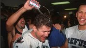 8 Oct 1995: SEATTLE SECOND BASEMAN LUIS SOJO DOUSES HERO EDGAR MARTINEZ IN THE LOCKER ROOM AFTER THE MARINERS 6-5 VICTORY OVER THE NEW YORK YANKEES IN GAME FIVE OF THE AMERICAN LEAGUE PLAYOFFS IN SEATTLE, WASHINGTON.