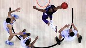 ATLANTA, GA - MARCH 22: Xavier Sneed #20 of the Kansas State Wildcats drives to the basket against PJ Washington #25 of the Kentucky Wildcats in the first half on March 22, 2018 in Atlanta, Georgia. (Photo by Kevin C. Cox/Getty Images)