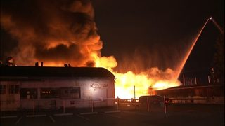 PHOTOS: Warehouse collapses in four-alarm fire in North Queen Anne