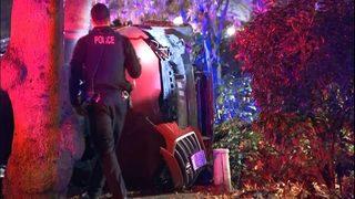 PHOTOS: Car flips onto side in Northgate crash
