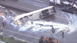 RAW: Semi overturns on I-5, spilling load of powdered milk