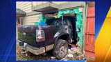 RAW: Surveillance video shows truck driving into Spanaway house