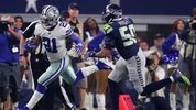 Ezekiel Elliott #21 of the Dallas Cowboys is pursued by #50 of the Seattle Seahawks in the first half during the Wild Card Round at AT&T Stadium on January 05, 2019 in Arlington, Texas. (Photo by Tom Pennington/Getty Images)