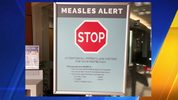 Signs posted at The Vancouver Clinic in Vancouver, Wash., warn patients and visitors of a measles outbreak on Wednesday, Jan. 30, 2019. (AP Photo/Gillian Flaccus)