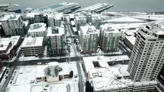 RAW: Drone flies over snowy Seattle