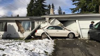 Crews respond after car plows into Bremerton home
