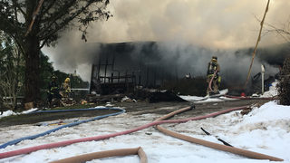 Crews battle mobile home fire in Monroe