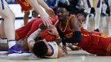 Washington's Matisse Thybulle, bottom left, and Southern California's Jonah Mathews fight for the ball during an NCAA college basketball game in the quarterfinal round of Pac-12 men's tournament on March 14, 2019, in Las Vegas. (AP Photo/John Locher)