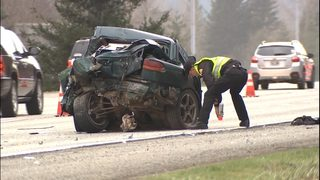 One killed in crash involving bus, car on I-90