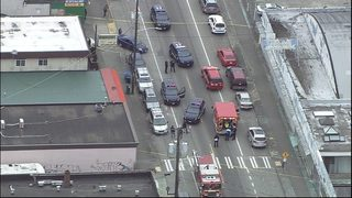 Man shot in back in drive-by outside market in West Seattle