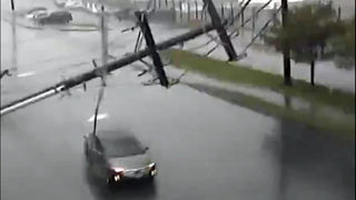 RAW: Traffic cameras record power poles falling in Tukwila