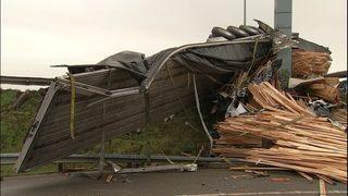Semi loses load of lumber on I-5 in Everett, blocks lanes