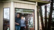 Paul and Karen Strand stand for a portrait in their home in Lacey, Wash., April 6, 2019. Both experienced the 1949 earthquake. Karen was attending Jefferson Elementary and Paul was home with the mumps in SeaTac.(Joshua Bessex/The Tacoma News Tribune)