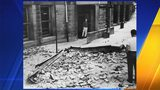 In this April 13, 1949 photograph, brick debris at the Lowell School marks the location of Marvin Klegman's death during the 1949 earthquake. The bricks fell from the fourth floor of the school. (Richards Studio Collection Tacoma Public Library)