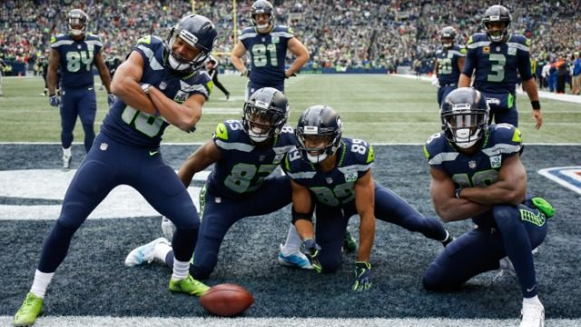 47beac3af Tyler Lockett #16 of the Seattle Seahawks celebrates a second quarter  touchdown with teammates in the game against the San Francisco 49ers at  CenturyLink ...