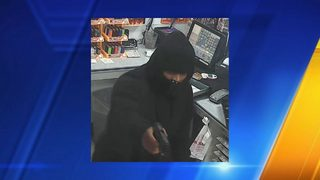Deputies searching for man suspected of shooting clerk in armed robbery of Tacoma gas station