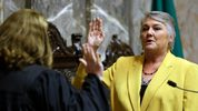 In this Jan. 9, 2017 file photo, Sen. Maureen Walsh, R-Walla Walla, right, takes the oath of office on the opening day of the 2017 legislative session at the Capitol in Olympia, Wash. (AP Photo/Ted S. Warren, File)