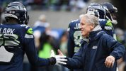 Seattle Seahawks head coach Pete Carroll greets Frank Clark #55 on the field before the game against the Los Angeles Rams at CenturyLink Field on December 17, 2017 in Seattle, Washington. (Photo by Steve Dykes/Getty Images)