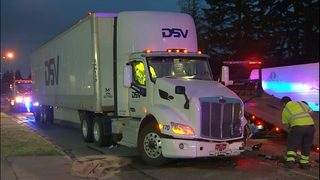 RAW: SUV slams into semi-truck in Everett