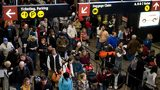 Travelers wait in line for their flights at the Seattle-Tacoma International Airport December 22, 2008 in Seattle, Washington (Photo by Stephen Brashear/Getty Images)