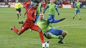 Chad Marshall #14 of the Seattle Sounders looks to make a play against Tosaint Ricketts #87 of the Toronto FC during the 2016 MLS Cup at BMO Field on December 10, 2016 in Toronto. (Photo: Claus Andersen/Getty Images)
