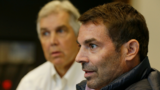 Chris Hansen, right, the investor who is seeking to build an arena that could host an NBA basketball team near Safeco Field in Seattle, takes part in an interview with the Associated Press, Tuesday, Oct. 10, 2017, in Seattle. (AP Photo/Ted S. Warren)