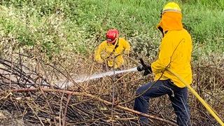 PHOTOS: Crews battle brush fire off SR 18