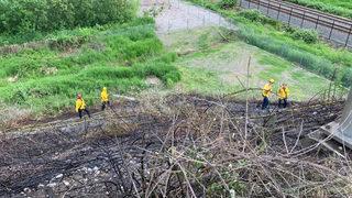 Fire crews battle brush fire off SR 18