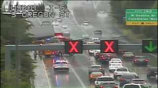 Semitruck crashes, partially hangs over concrete barrier on northbound I-5 in Seattle