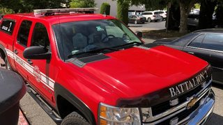 Man steals fire department pickup truck while crews battle blaze, fire chief says