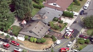 RAW: 2-alarm fire in Kirkland spreads to neighboring home