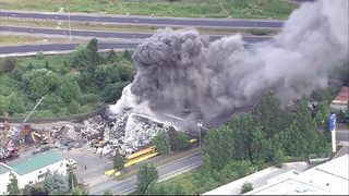 VIDEO: Crews battle scrap metal fire in Woodinville