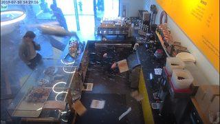 RAW: Car crashes into Seattle doughnut shop