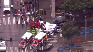 RAW: Car crashes into downtown Seattle doughnut shop