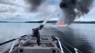 RAW: Olympia firefighters extinguish boat fire on Puget Sound