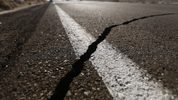 A crack stretches across the road after a 6.4 magnitude earthquake struck the area on July 4, 2019 near Ridgecrest, California.(Photo by Mario Tama/Getty Images)