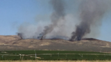 VIDEO: Evacuation levels reduced overnight in Grant County wildfire