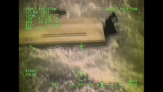 RAW: Coast Guard rescues 3 stranded on beach in Alaska