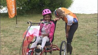 RAW: 10-year-old girl surprised with custom adaptive bicycle