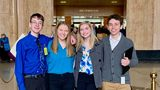 """From left, Sam Adamson, Lori Riddle, Hailey Hardcastle, and Derek Evans pose at the Oregon State Capitol in Salem, Ore after introducing legislation to allow students to take """"mental health days"""" (Jessica Adamson/Providence Health & Services via AP)"""