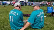Travis Henry (L) and Dave Henry await the start of the Baseball Hall of Fame induction ceremony at Clark Sports Center on July 21, 2019 in Cooperstown, New York. (Photo by Jim McIsaac/Getty Images)