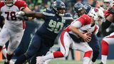 Jarran Reed #90 of the Seattle Seahawks sacks Josh Rosen #3 of the Arizona Cardinals in the third quarter at CenturyLink Field on December 30, 2018 in Seattle, Washington. (Photo by Abbie Parr/Getty Images)