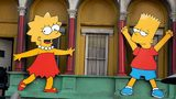 "Lisa Simpson and Bart Simpson cut-outs on display at ""The Simpsons"" 350th episode block party on the New York street of Fox Pico Lot on April 25, 2005 in Los Angeles, California. (Photo by Stephen Shugerman/Getty Images)"